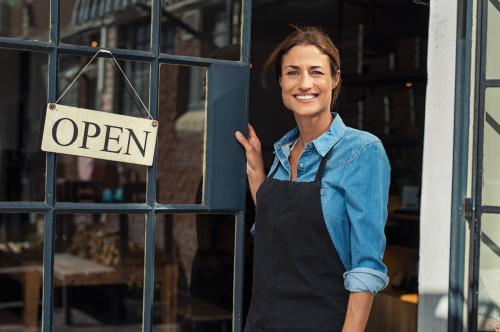 business owner in front of her store